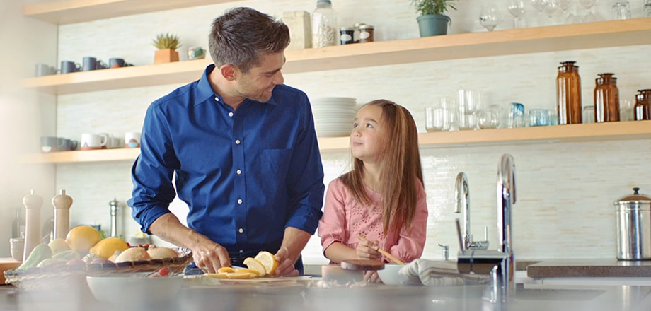 Refrigerator - father and daughter spending time in kitchen